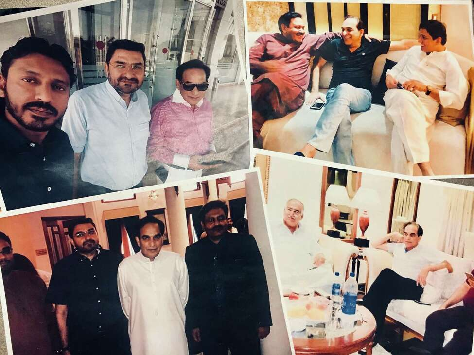 A collage of print-outs of photos posted to social media over the past year of Shahed Hussain in his native Pakistain. The people Hussain is pictured with are prominent business and political leaders in the Punjab region where Hussain grew up.