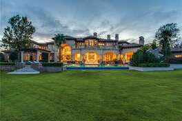 Former New York Yankees star Vernon Wells III's mansion in Westlake, Texas is a 16,238-square-foot Mediterranean-inspired villa sits on nearly 2 acres.