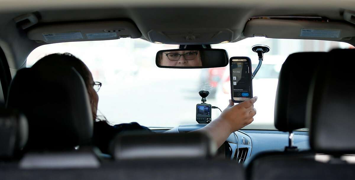 Driver Lilianna Carrasco, receives delivery order on app ease via phone as she gets ready to make a delivery at Caliva in San Jose, Calif., on Nov. 20, 2018. Uber, Lyft drivers are fleeing to become marijuana-delivery drivers � the new in-demand job in the on-demand economy. Caliva employs more than a hundred drivers. (Josie Lepe/Special to the Chronicle)