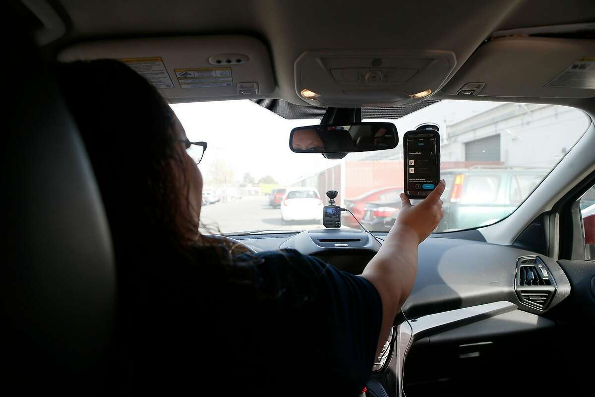 Driver Lilianna Carrasco, receives a delivery order on the Eaze app as she gets ready to make a delivery at Caliva in San Jose, Calif., on Nov. 20, 2018. Uber, Lyft drivers are fleeing to become marijuana-delivery drivers � the new in-demand job in the on-demand economy. Caliva employs more than a hundred drivers. (Josie Lepe/Special to the Chronicle)