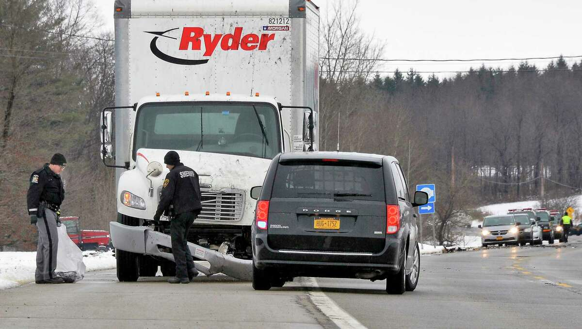 State Police and sheriff's department investigators pore over the scene of an accident that killed Trooper Jeremy VanNostrand on Tuesday, Nov. 27, 2018, in Glen, Montgomery County. (John Carl D'Annibale/Times Union)