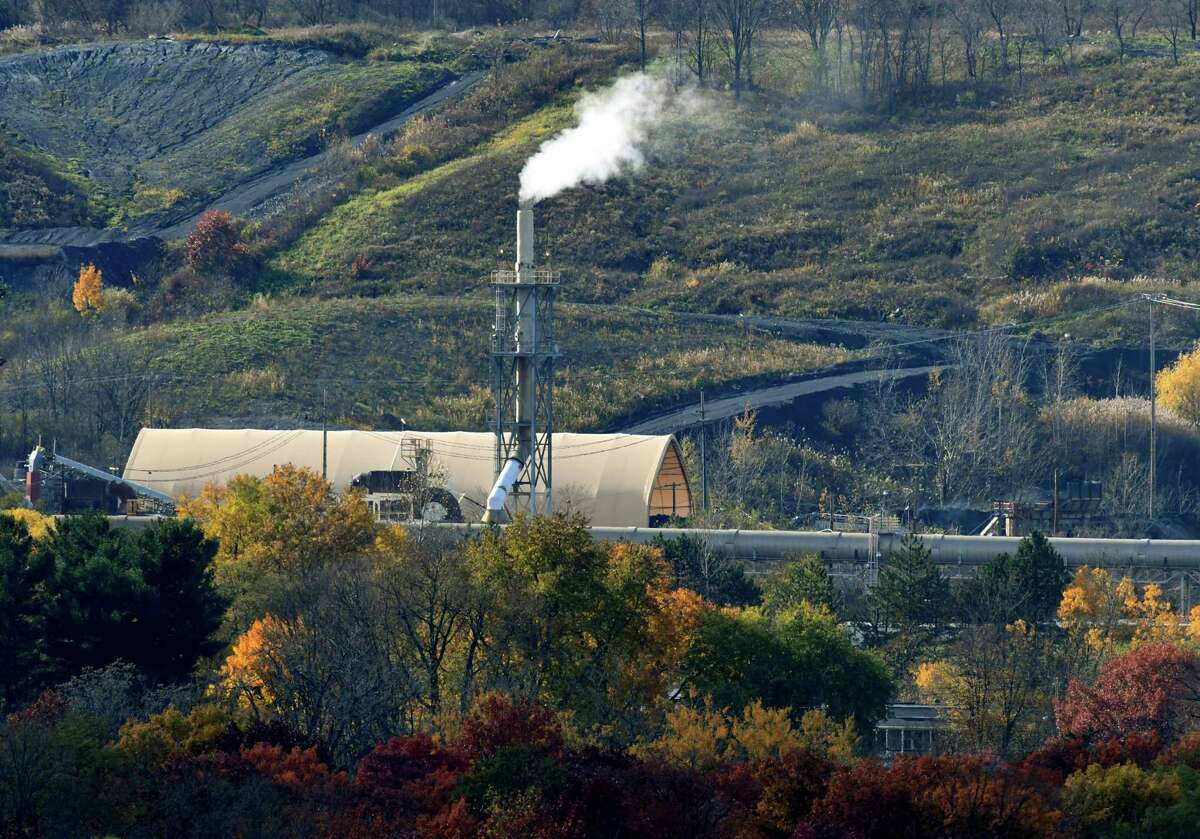 Emissions rise from the Norlite plant on Wednesday, Nov. 7, 2018, in Cohoes, N.Y. Owners of the state's only commercial hazardous waste incinerator are announcing a $30 million project to upgrade pollution control equipment. (Will Waldron/Times Union)