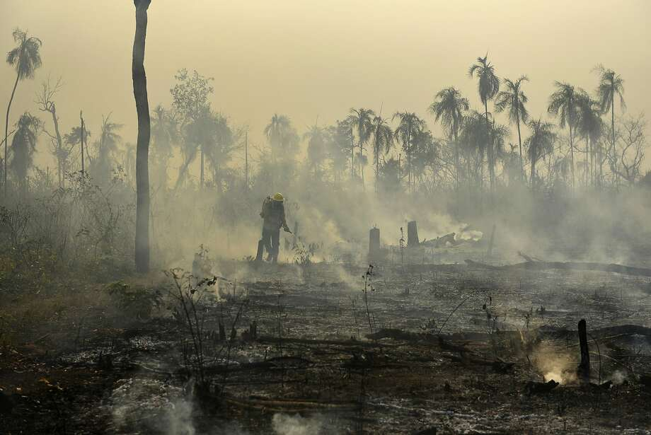 Members of the National Center to Prevent and Combat Forest Fires fought a blaze in 2017 affecting indigenous lands in Maranhao state in Brazil's Amazon basin. Photo: Felipe Werneck / Associated Press 2017