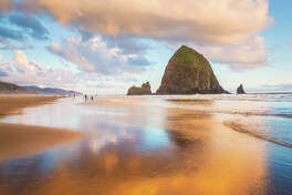 Golden Hour on Cannon Beach with Haystack Rock and reflections - very dramatic
