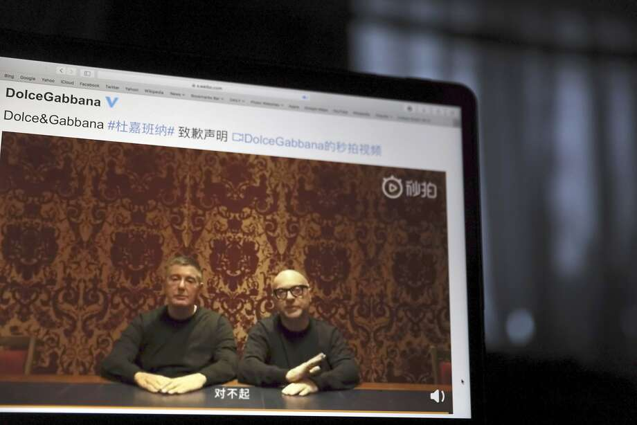 """Stefano Gabbana (left) and Domenico Dolce, founders of Dolce & Gabbana, apologize in a Nov. 23, 2018, video on Chinese social media, saying """"sorry"""" in Mandarin seen on a computer screen in Beijing, China.Prominent Chinese and Chinese American San Franciscans are expressing their dismay over the incidents, even if recent events are not exactly a surprise to fashion followers. Photo: Ng Han Guan / Associated Press"""