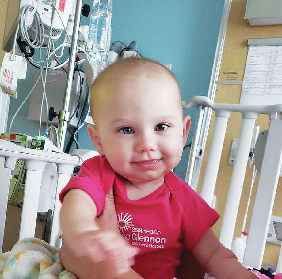 Harleigh Miller, 6 months old, of Granite City, at the hospital where she undergoes outpatient treatment for a rare muscle cancer called rhabdomyosarcoma. The Benefit for Harleigh will raise money for her and her parents, Britney and Ryne Miller, for medical expenses and other family expenses related to Harleigh's medical needs. Photo: For The Telegraph