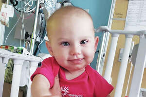 Harleigh Miller, 6 months old, of Granite City, at the hospital where she undergoes outpatient treatment for a rare muscle cancer called rhabdomyosarcoma. The Benefit for Harleigh will raise money for her and her parents, Britney and Ryne Miller, for medical expenses and other family expenses related to Harleigh's medical needs.