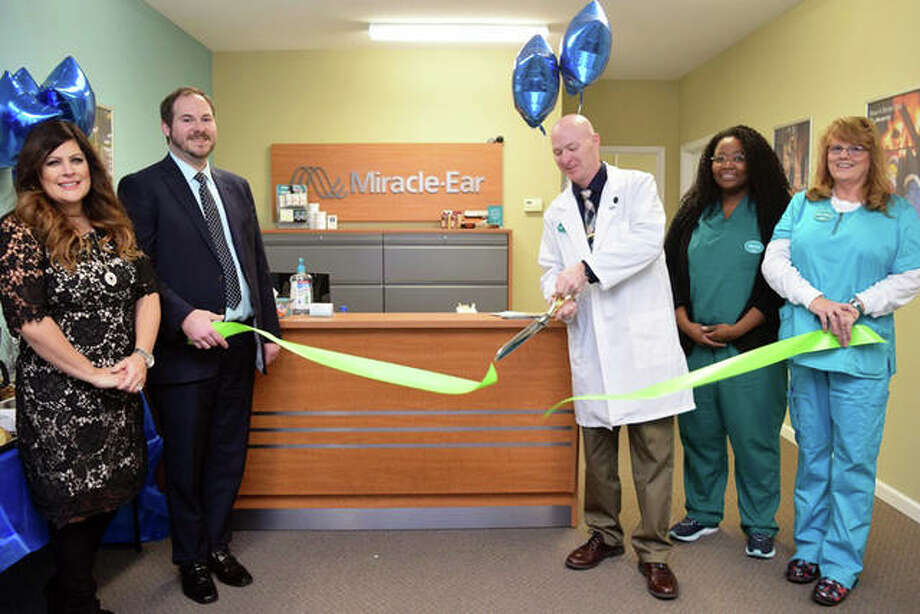 A ribbon-cutting ceremony on Tuesday at the brand new Miracle-Ear facility, located at 5 Club Centre Court, Suite B, Edwardsville, celebrated the business' new location. Staff members pictured, from left to right, are Tiffany Davis, Nathan Bush, Mark McClure, Jennifer Coleman, and Kathy Riddle. Photo: For The Intelligencer