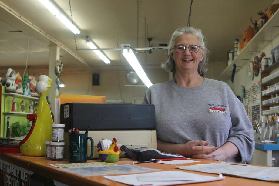 Laurie Cook, manager of Cloud of Dust Ceramics, stands behind the counter at the shop located at 6065 W. Richardson Rd. in Pigeon. Photo: Mike Gallagher/Huron Daily Tribune