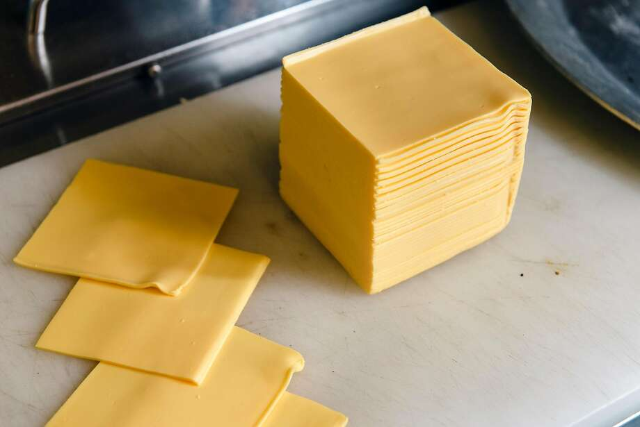 A stack of American cheese slices sits on the counter at chef Mike Yoon's pop-up diner Lovely's, serving Americana food, inside The Lodge bar in Oakland in Oakland, California, on Wednesday, November 21, 2018. Photo: Michael Short / Special To The Chronicle