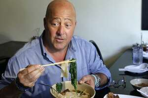 """FILE - In this Thursday, July 20, 2017, file photo, Travel Channel's """"Bizzare Foods"""" host Andrew Zimmern, a four-time James Beard award-winning chef, samples Taiwanese noodle soup and pork roll at Happy Stony Noodle in Elmhurst, Queens in New York. Zimmern is apologizing for his comments about Chinese restaurants after he was criticized as culturally insensitive. Last week, Fast Company posted an interview from the summer in which Zimmern says he was saving the souls of people who dine at """"(expletive) restaurants masquerading as Chinese food"""" in the Midwest. (AP Photo/Kathy Willens, File)"""