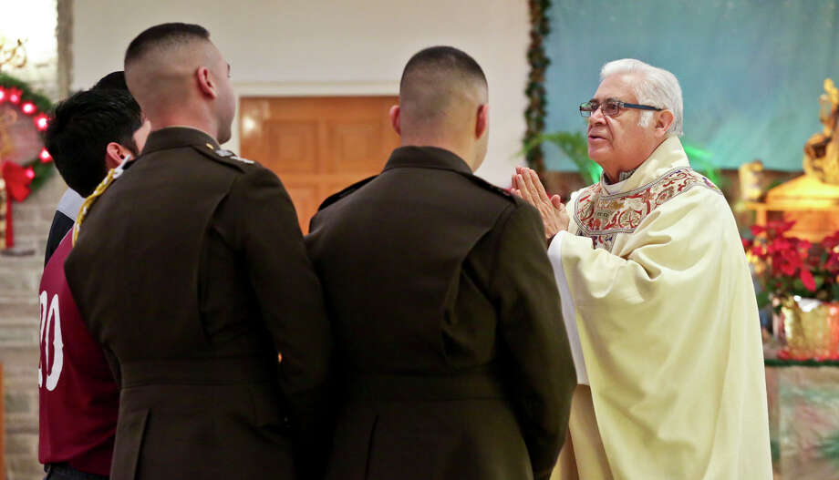 Texas A&M University students receive a blessing from Father Jose Luis Balderas during the 23rd Annual J.J. Sanchez Memorial Mass at Christ the King Church in 2016. Photo: Victor Strife/Laredo Morning Times