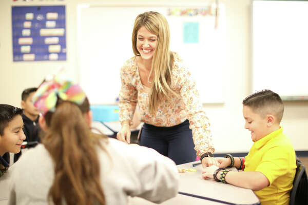 Leeann Higgenbotham, fifth grade science and social studies teacher, works with her South Elementary students Nov. 27, 2018. James Durbin/Reporter-Telegram