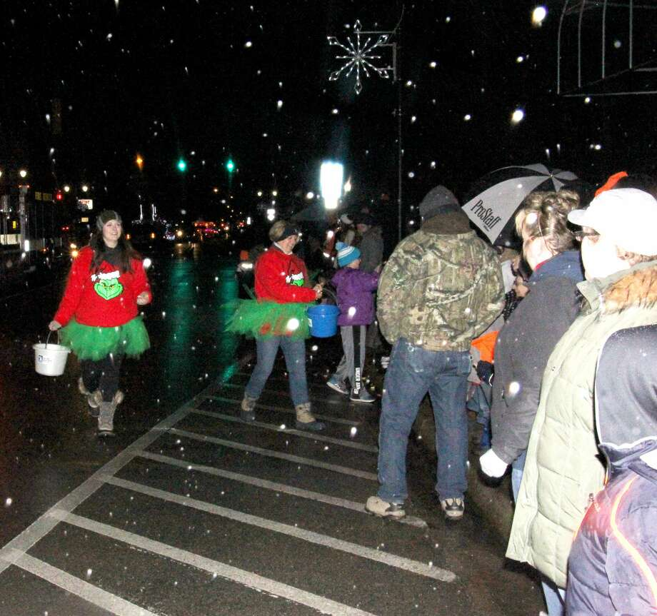 During a gentle snowfall, some of the Grinch's friends were spotted passing out candy to the little Who boys and Who girls Saturday during Bad Axe's annual Christmas parade. Photo: Bradley Massman/Huron Daily Tribune