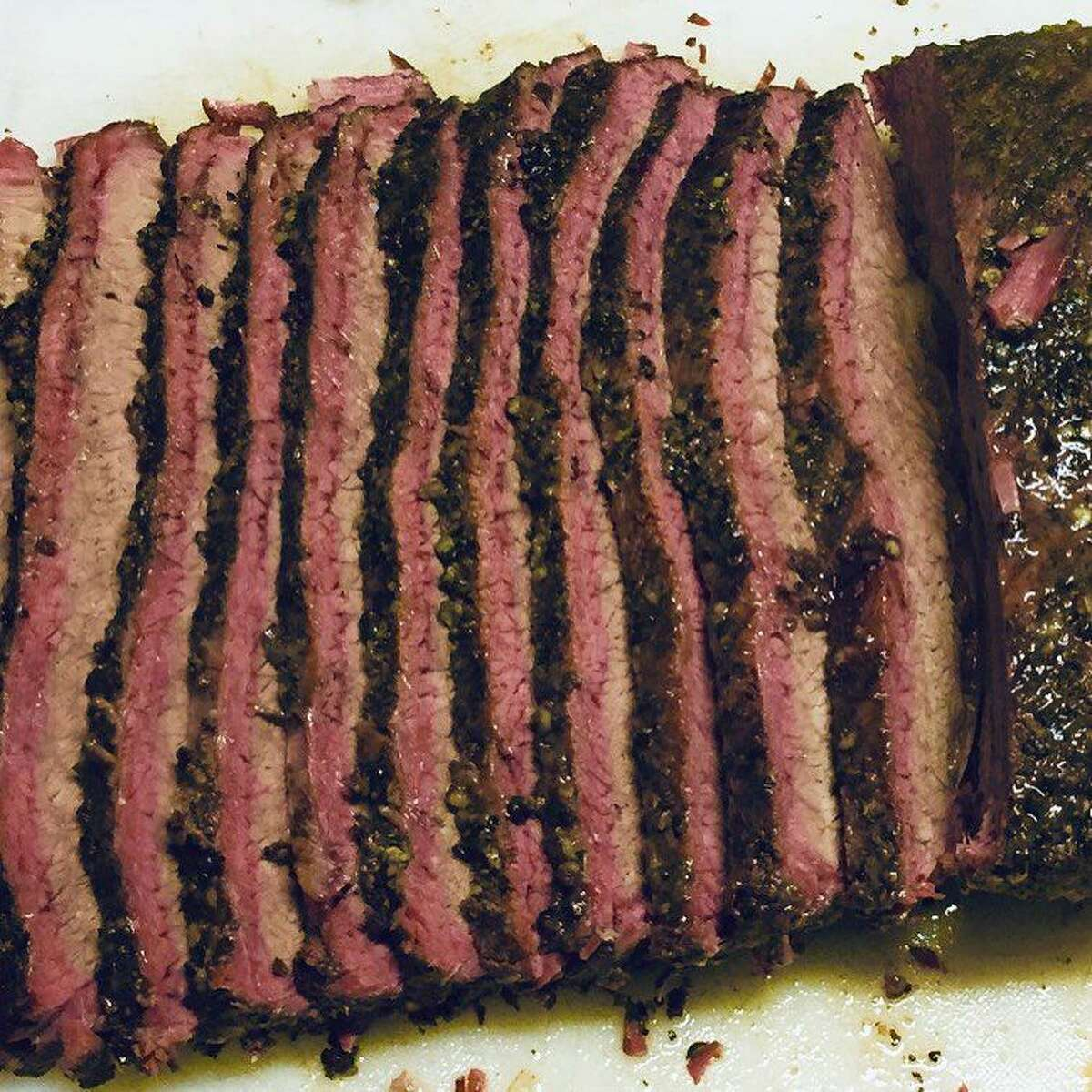 Fresh slices of brisket off the 1836 BBQ pit.