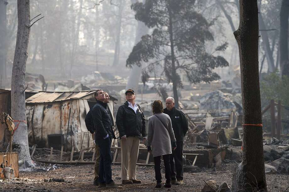 Gov.-elect Gavin Newsom, FEMA Director Brock Long, President Donald Trump, Paradise mayor Jody Jones and Gov. Jerry Brown tour the Skyway Villa Mobile Home and RV Park, during Trump's visit of the Camp Fire in Paradise, Calif. on Saturday, Nov. 17, 2018, in Chico, Calif. (Paul Kitagaki Jr./The Sacramento Bee via AP, Pool) Photo: Paul Kitagaki Jr. / Associated Press