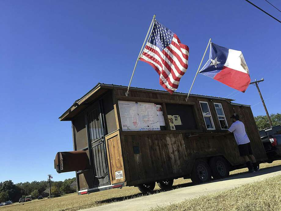 The Mesquite Shack BBQ trailer in San Antonio pulls double duty as a sales window and smokehouse. It will be at the Toni Jo's Food Truck Park in Helotes on Friday for the season debut. Photo: Mike Sutter /Staff File Photo
