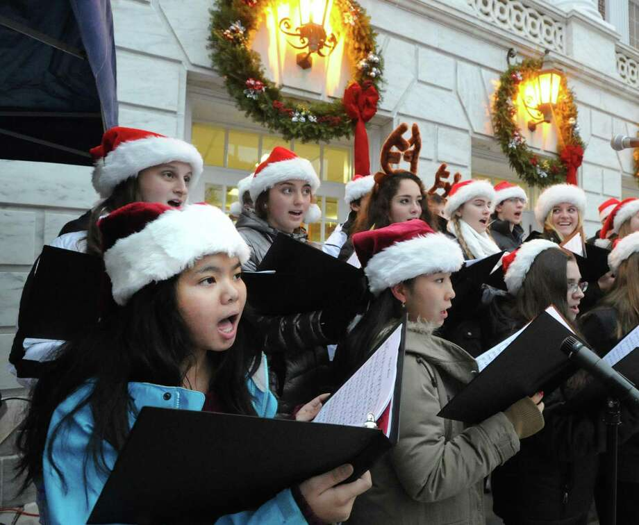 The Greenwich High School Chamber Singers will perform holiday classics at the town's annual Christmas tree-lighting ceremony at Town Hall from 4 to 4:45 p.m. Friday. There will also be visits from Santa, Frosty the Snowman and Rudolph the Red-Nosed reindeer along with rides on a mechanical polar bear and reindeer. Wintry refreshments, including hot cider, hot chocolate, cookies and candy canes, will be served. Photo: File / Hearst Media Connecticut / Greenwich Time