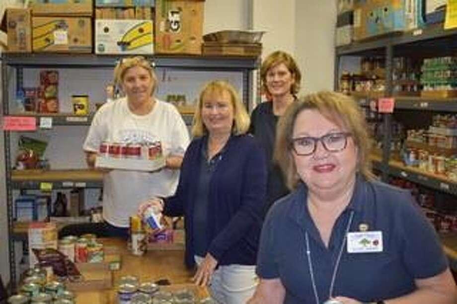 Cypress-Woodlands Junior Forum members (from left to right) Daniela Byland, Glenda Corley, Shelly Craft and Vickie Shenk serving at Tomball Emergency Assistance Ministries. Photo: Cypress-Woodlands Junior Forum