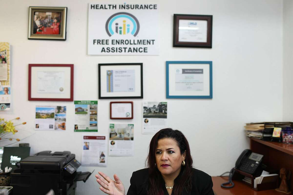 Monica Tracht, a San Francisco insurance agent, speaks to a client in her office in July. Researchers fear that changes to the Affordable Care Act could result in hundreds of thousands of Californians becoming uninsured by 2023.