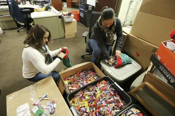 Soldiers Angels' staffers Sheila Williams (right) and Vanessa Vinton (left) puts handfuls of candy into stockings which will be sent out to members of the armed services on Tuesday, Nov. 13, 2018. Through donations, the organization has locally collected about 17,000 pounds of candy according to officials. Soldiers Angels is a volunteer network in 50 states and 31 countries to support service members, military families, and veterans of all eras. The organization has sent 851,000 care packages to deployed service members since 2003. (Kin Man Hui/San Antonio Express-News)