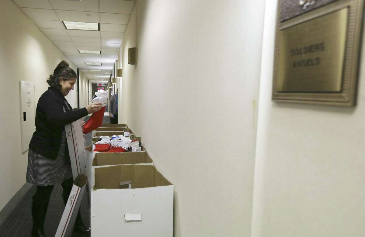 Soldiers Angels' Director of Marketing and Communications Michelle Julazadeh Chavarin shows how they pack stockings into delivery boxes which will be sent out to members of the armed services on Tuesday, Nov. 13, 2018. Soldiers Angels is a volunteer network in 50 states and 31 countries to support service members, military families, and veterans of all eras. The organization has sent 851,000 care packages to deployed service members since 2003. (Kin Man Hui/San Antonio Express-News)