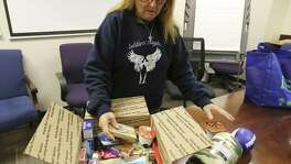 Soldiers Angels' staffer Sandy Carter shows items they place into a care package that will be sent out to members of the armed services on Tuesday, Nov. 13, 2018. Soldiers Angels is a volunteer network in 50 states and 31 countries to support service members, military families, and veterans of all eras. The organization has sent 851,000 care packages to deployed service members since 2003. (Kin Man Hui/San Antonio Express-News)