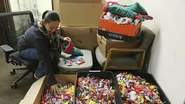 Soldiers Angels' staffer Sheila Williams puts handfuls of candy into a stocking which will be sent out to members of the armed services on Tuesday, Nov. 13, 2018. Through donations, the organization has locally collected about 17,000 pounds of candy according to officials. Soldiers Angels is a volunteer network in 50 states and 31 countries to support service members, military families, and veterans of all eras. The organization has sent 851,000 care packages to deployed service members since 2003. (Kin Man Hui/San Antonio Express-News)