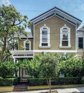$1,800/night 4 beds, 2.5 baths in Hayes Valley - This huge historic farmhouse includes a grand staircase, gas fireplace, and a 1914 Steinway grand piano. There is also a lush front garden and roses in the backyard. The house still has many of the original interior details from when it was built in 1869.