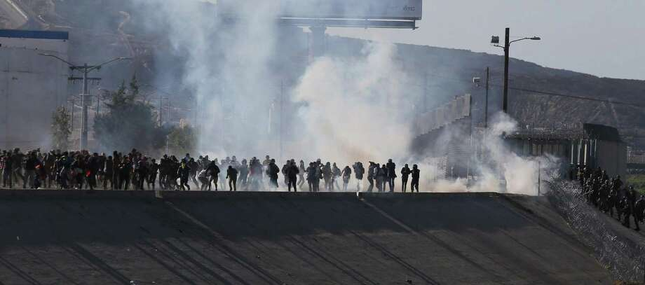 View of tear gas that border police used to prevent groups of people from crossing the US-Mexico border at El Chaparral on Sunday, Nov. 25, 2018 in Tijuana, Baja California, Mexico. A group of migrants from the caravan of Central Americans who advanced today towards the San Ysidro (USA) gateway deviated from the planned route to try to cross the border wall by other points, while the U.S. border police used tear gas. (David Guzman/EFE/Zuma Press/TNS) Photo: David Guzman/EFE, MBR / TNS / Zuma Press