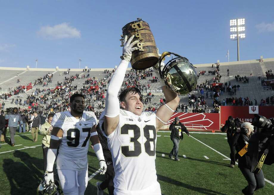 Purdue's Brennan Thieneman holds up the Old Oaken Bucket after Purdue defeated Indiana 28-21 on Saturday. Photo: Darron Cummings / Associated Press / Copyright 2018 The Associated Press. All rights reserved
