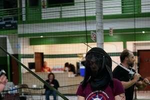 Sky Hilton participates in a sword class.