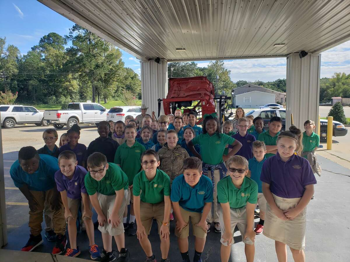 Students at Jasper Classical Academy participated in a demonstration of the Rollover Convincer, a machine that lets students see what it is like to be in a rollover crash. The demonstration stresses the importance of wearing a seatbelt.