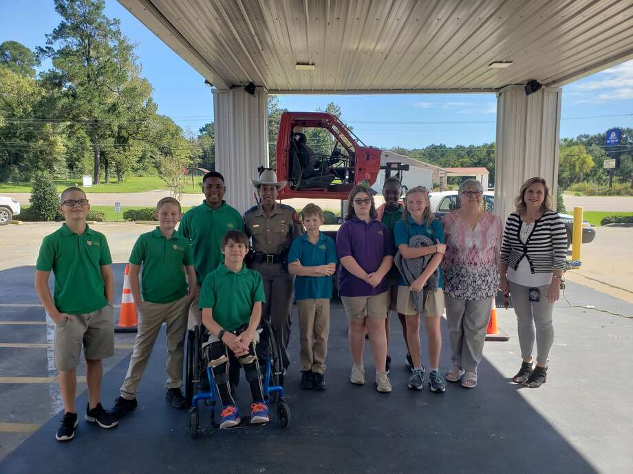 Students at Jasper Classical Academy participated in a demonstration of the Rollover Convincer, a machine that lets students see what it is like to be in a rollover crash. The demonstration stresses the importance of wearing a seatbelt.  Photo: Andrea Whitney