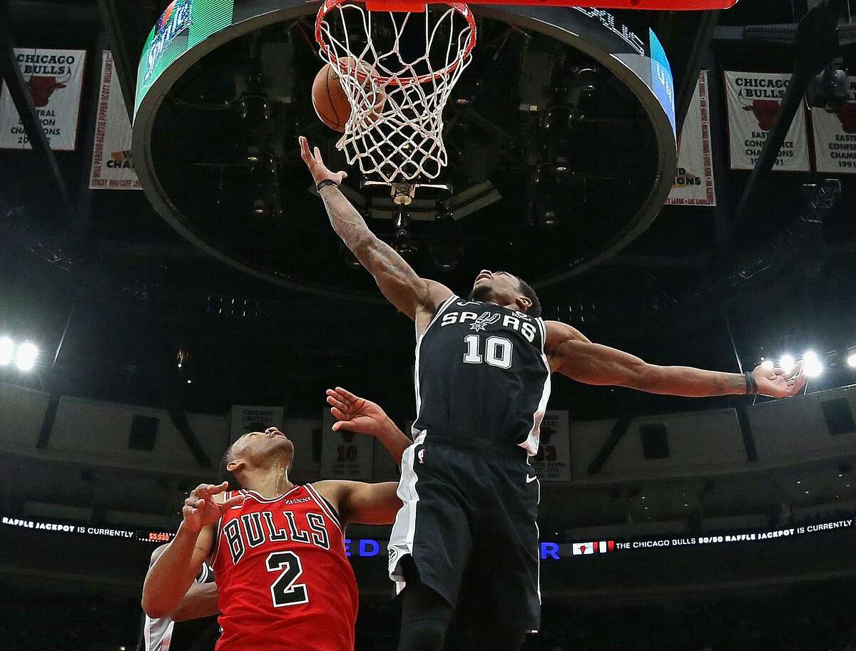 CHICAGO, ILLINOIS - NOVEMBER 26: DeMar DeRozan #10 of the San Antonio Spurs rebounds over Jabari Parker #2 of the Chicago Bulls at the United Center on November 26, 2018 in Chicago, Illinois. The Spurs defeated the Bulls 108-107. NOTE TO USER: User expressly acknowledges and agrees that, by downloading and or using this photograph, User is consenting to the terms and conditions of the Getty Images License Agreement. (Photo by Jonathan Daniel/Getty Images)