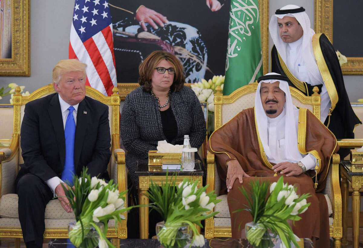 """(FILES) In this file photo taken on May 20, 2017 US President Donald Trump (L) and Saudi Arabia's King Salman bin Abdulaziz al-Saud (R) meet in Riyadh. - Trump on November 21, 2018, thanked Saudi Arabia for lower oil prices -- a day after pledging the US would remain a """"steadfast partner"""" of the kingdom despite the murder of a prominent journalist. """"Oil prices getting lower. Great! Like a big Tax Cut for America and the World. Enjoy! $54, was just $82,"""" he tweeted. """"Thank you to Saudi Arabia, but let's go lower!"""" (Photo by MANDEL NGAN / AFP)MANDEL NGAN/AFP/Getty Images"""