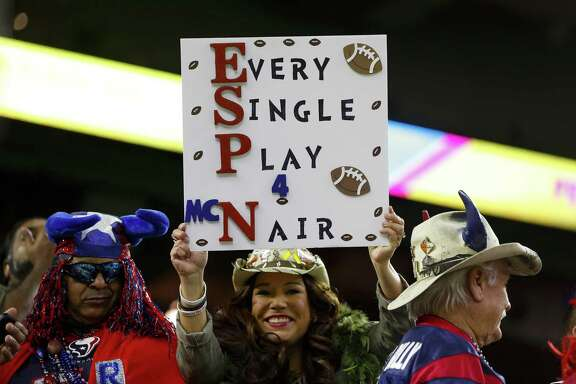 A Texans fan holds a sign honoring Texans owner Bob McNair before the first quarter of an NFL football game at NRG Stadium on Monday, Nov. 26, 2018, in Houston.
