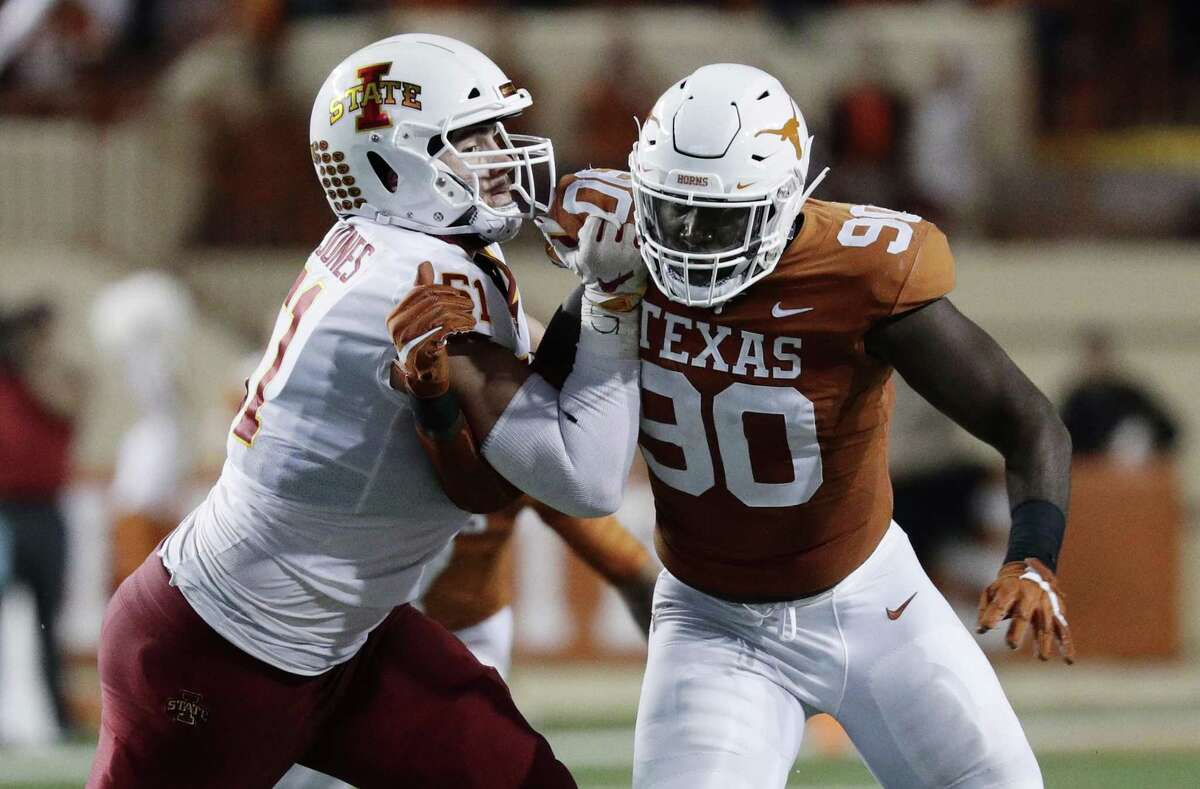 Texas defensive lineman Charles Omenihu (90) during the first half of an NCAA college football game against Iowa State , Saturday, Nov. 17, 2018, in Austin, Texas. (AP Photo/Eric Gay)
