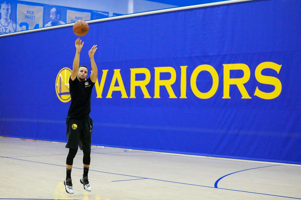 Warriors player Stephen Curry takes a shot during Golden State Warriors' practice in Oakland, California, on Monday, Nov. 26, 2018.
