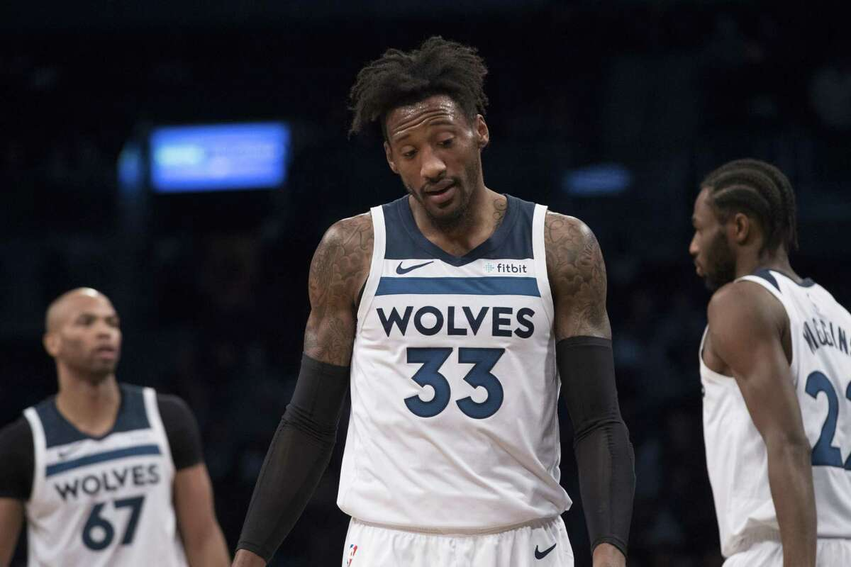 Minnesota Timberwolves forward Robert Covington (33) reacts during the first half of an NBA basketball game against the Brooklyn Nets, Friday, Nov. 23, 2018, in New York. (AP Photo/Mary Altaffer)