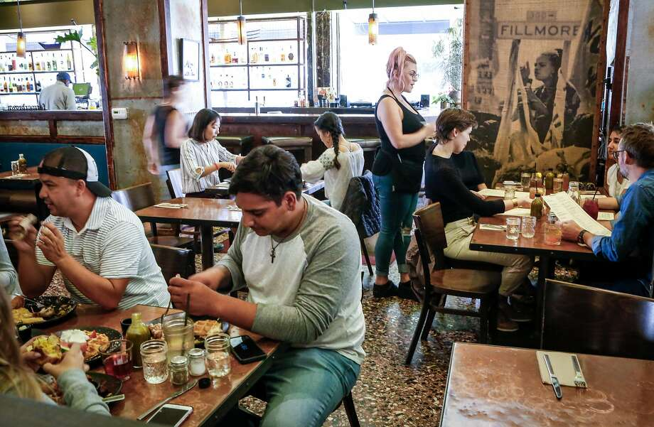 Patrons fill the dining room of a San Francisco restaurant. Click on the slideshow ahead to see why San Franciscans are bad diners. Photo: Amy Osborne, Special To The Chronicle