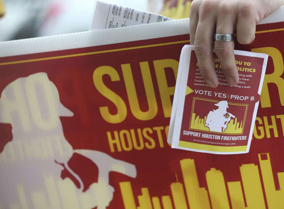 Houston Fire Department firefighters hand out fliers to advocate for Prop B on Election Day, Nov. 6, 2018, in Houston. Photo: Yi-Chin Lee, Houston Chronicle / Staff Photographer / © 2018 Houston Chronicle