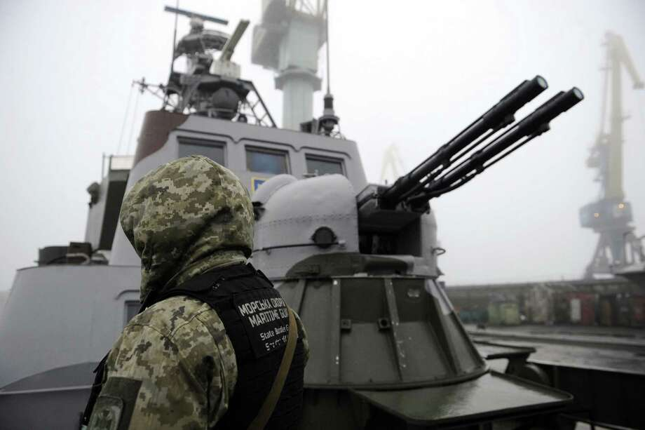 "TOPSHOT - Ukrainian soldier patrols aboard military boat called ""Dondass"" moored in Mariupol, Sea of Azov port on November 27, 2018. - Three Ukrainian navy vessels were seized off the coast of Crimea by Russian forces, which fired on and boarded Kiev's ships after several tense hours of confrontation. Here's what is known about Sunday's incident. (Photo by Sega VOLSKII / AFP)SEGA VOLSKII/AFP/Getty Images Photo: SEGA VOLSKII / AFP or licensors"