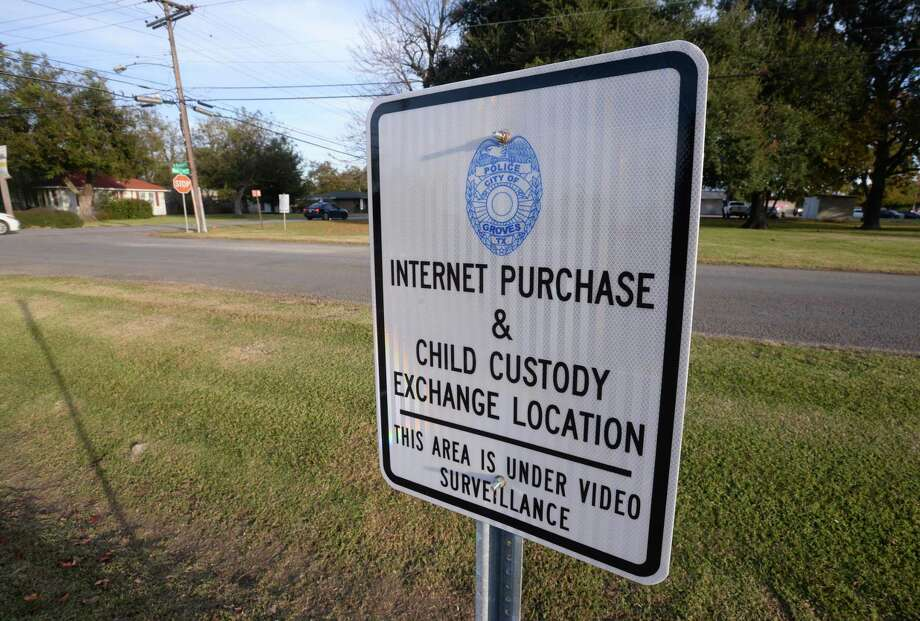 A sign indicates the parking lot at the Groves Police Department a safe place to change custody of children and internet purchases.    Photo taken Tuesday, 11/27/18 Photo: Guiseppe Barranco/The Enterprise, Photo Editor / Guiseppe Barranco ©