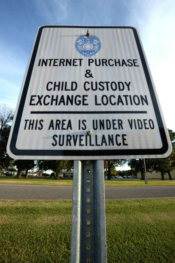 A sign indicates the parking lot at the Groves Police Department a safe place to change custody of children and internet purchases.  