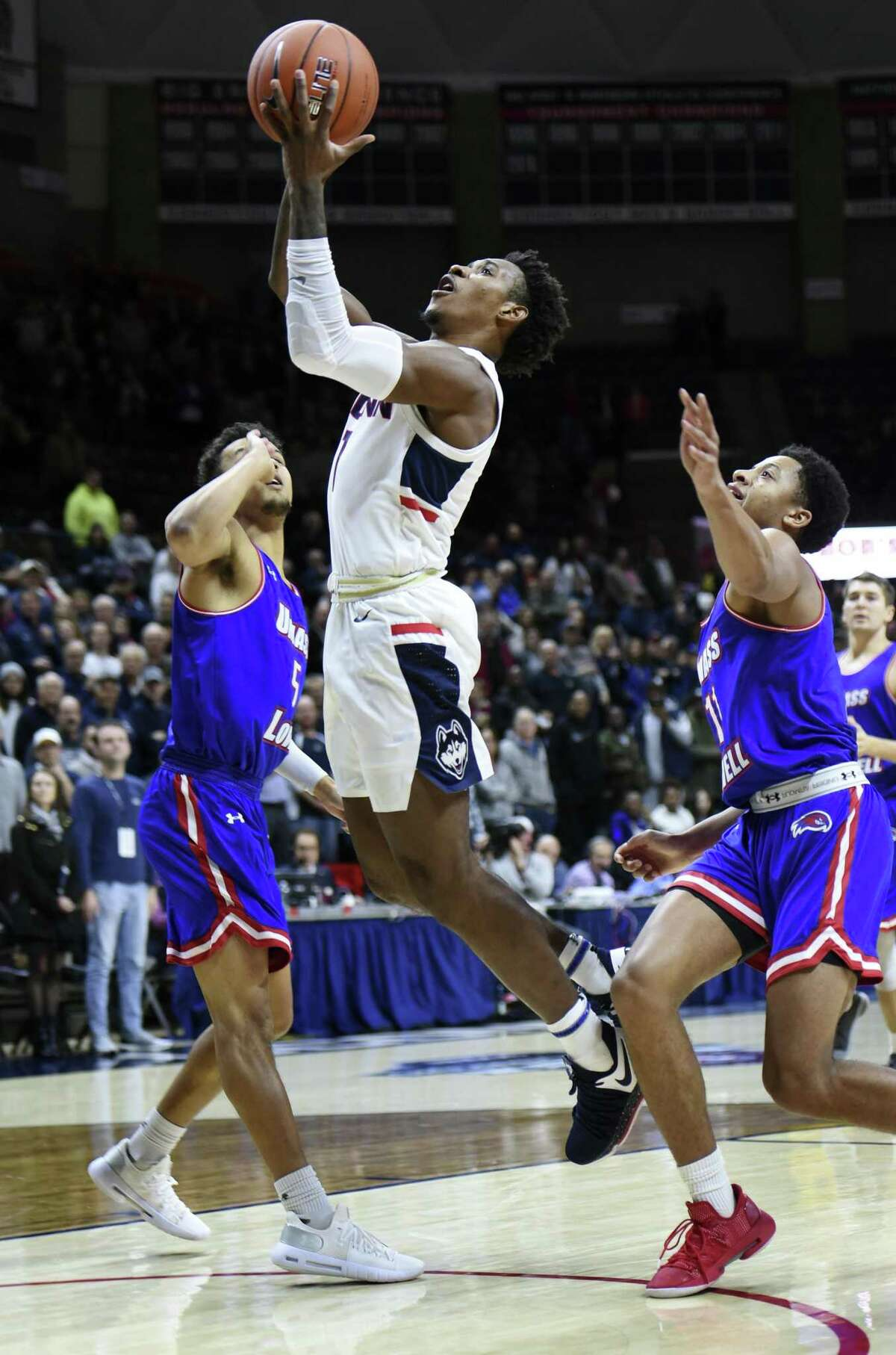 UConn's Christian Vital (1) goes up for two of his 17 points in the first half during an NCAA college basketball game against UMass-Lowell, Tuesday, Nov. 27, 2018, in Storrs, Conn. (AP Photo/Stephen Dunn)