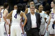 Connecticut head coach Geno Auriemma talks to his team during a time out in the first half of a women's NCAA college basketball game against Ohio State Sunday, Nov. 11, 2018, in Storrs, Conn.(AP Photo/Stephen Dunn)