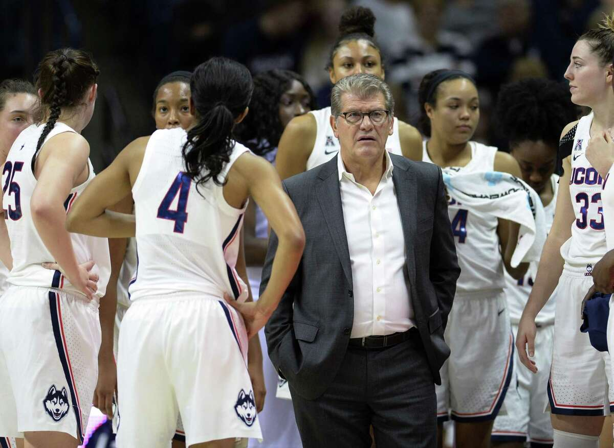UConn coach Geno Auriemma talks to his team during a timeout against Ohio State on Nov. 11.
