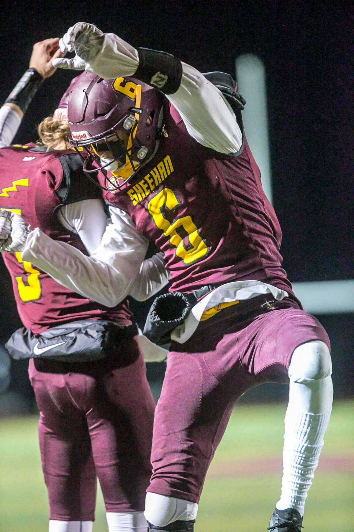 (John Vanacore/For Hearst Connecticut Media) Sheehan's Jake Smith celebrates his first half touchdown with Weston Terzi(3) during their CIAC Class M quarterfinal win Tuesday in Wallingford.