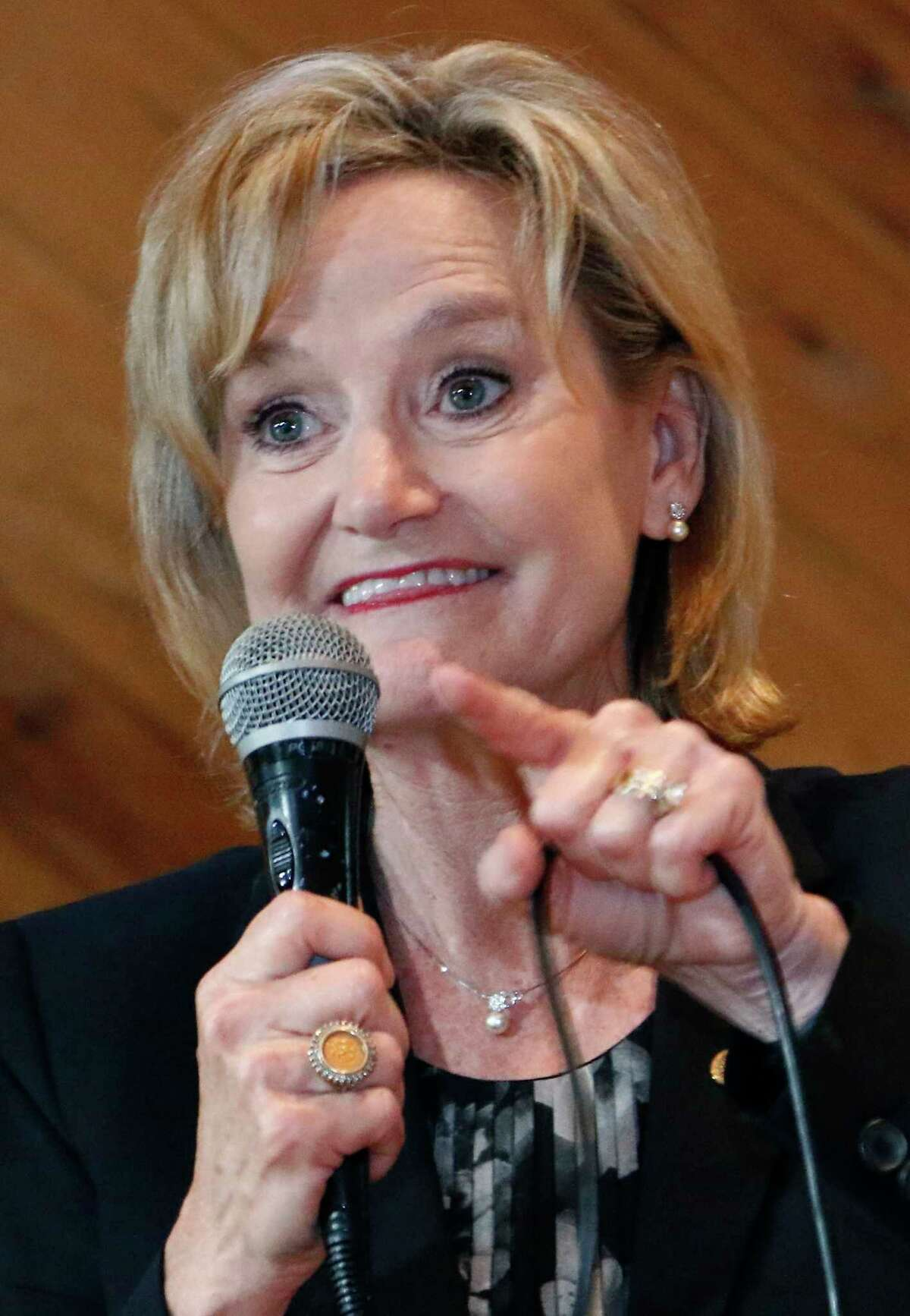 """FILE - In this Nov. 5, 2018, file photo, U.S. Sen. Cindy Hyde-Smith, R-Miss., addresses a gathering of supporters in Jackson, Miss. The last U.S. Senate race of the midterms was coming to a close Tuesday as Mississippi residents chose between Hyde-Smith, a white Republican Senate appointee whose """"public hanging"""" comments angered many people, and Mike Espy, a black Democrat who was agriculture secretary when Bill Clinton was in the White House."""